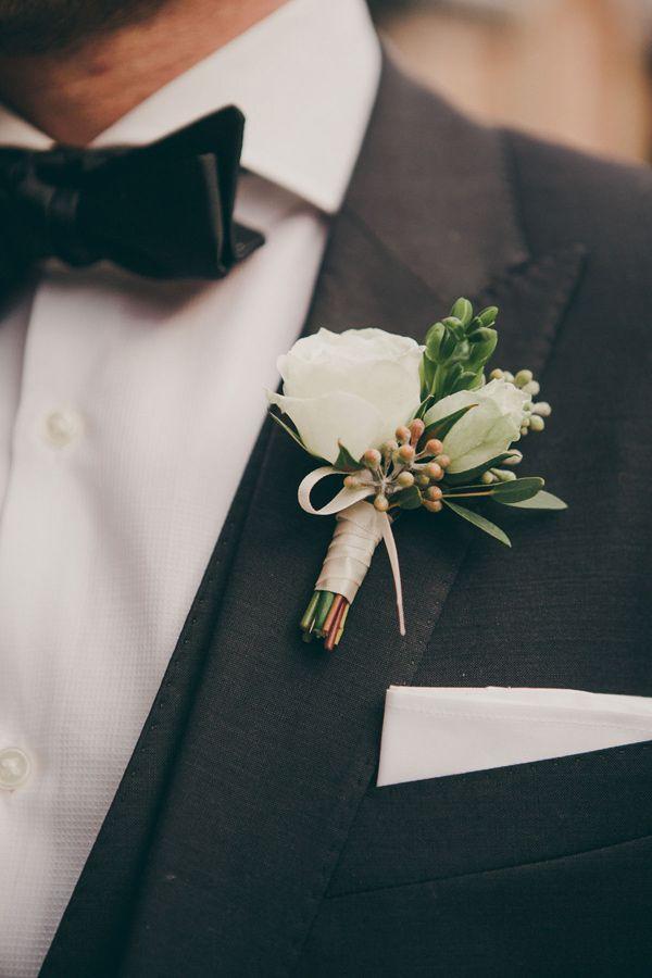 classic boutonniere + groom look, photo by Christine Lim http://ruffledblog.com/glam-toronto-hotel-wedding #boutonnieres #grooms