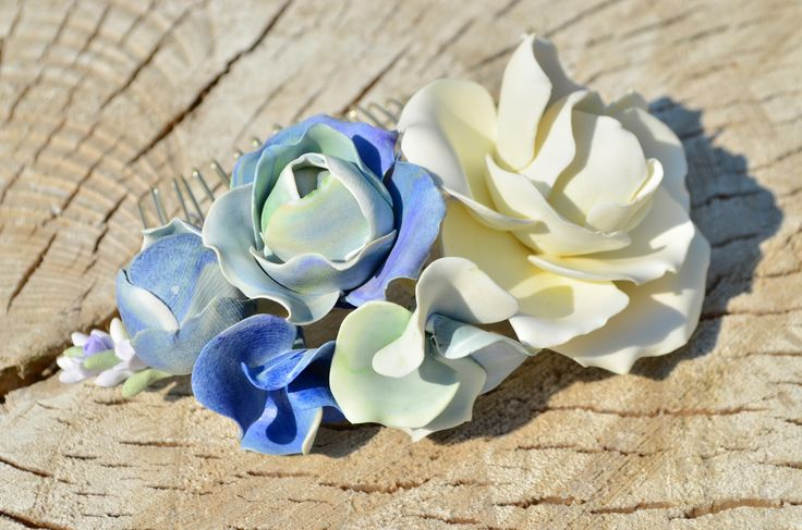 Pastel blues and cream combination in an amazing hair comb. Lavender, roses and hydrangeas handsculpted from polymer clay innette.etsy.com