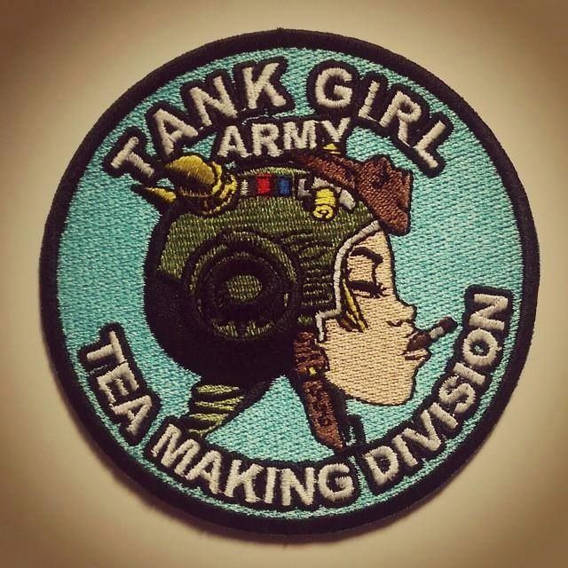 "The much sought-after ""Tank Girl Army, Tea Making Division"" embroidered, sew-on patch (approx 90mm diameter). 100% embroidered. Designed..."