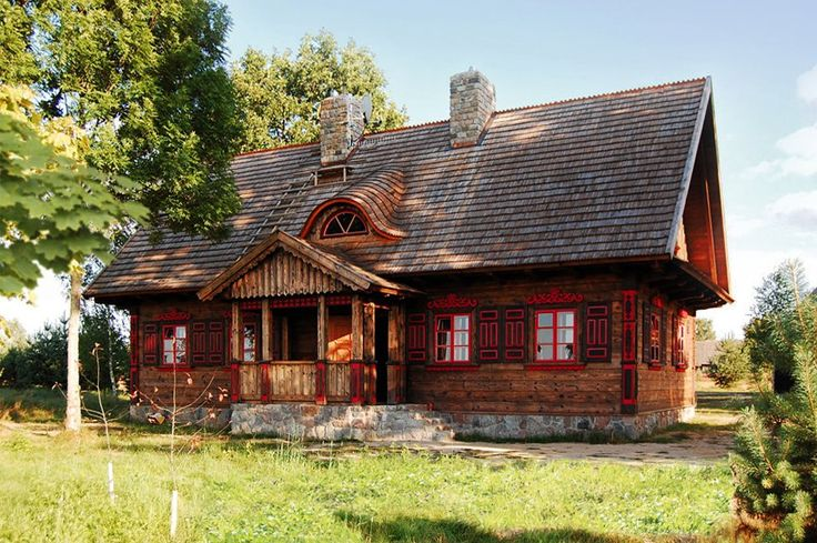 Wooden Architecture of Poland - typical architecture for Podlasie Voivodship. Pay attention to ornamental painted boards covering the corners of the house.