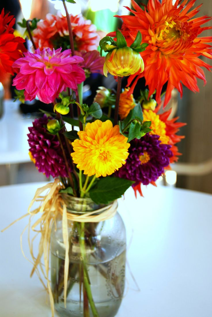 Mixed flowers bouquet in jar
