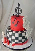 music themed twilight cake with chess peices, checkered pattern and music notes