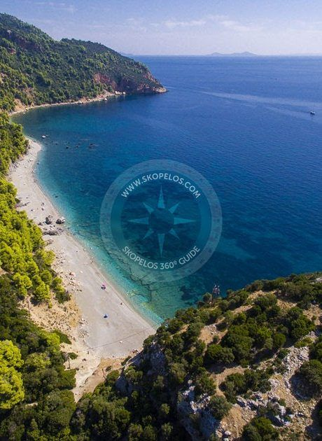 Velanio Beach #Skopelos  Velanio is an amazing pebble beach which is accessible on foot from Stafilos beach. Swimming at Velanio is an experience in itself. The water is deep blue and the only thing in sight is the beach and the side of the hill full of pine trees. It's a large beach which is divided by a large rock formation. The beach beyond the rocks is the official nudist beach of the island.