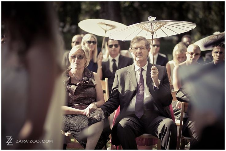 #Paper #Parasols used at this #outdoor #wedding at #Molenvliet Wine Estate near Stellenbosch, South Africa.  See more of this wedding on the ZaraZoo Photography blog http://www.zara-zoo.com/blog/molenvliet-wedding-photos-stellenbosch