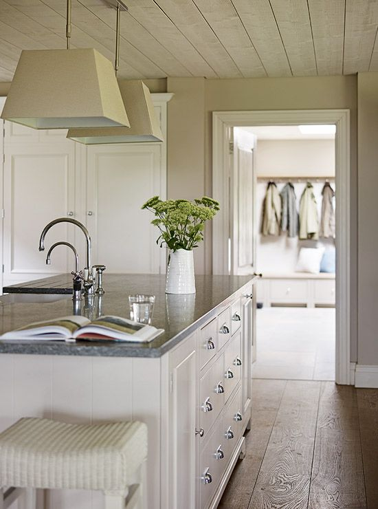 Classic country features, such as painted furniture and a large ceramic sink, are in keeping with the traditional farmhouse style and make the kitchen feel homely | Designed by Garry Meakins, head of design, Sims Hilditch | Photograph by Darren Chung | Homes & Gardens | http://www.hglivingbeautifully.com/2016/05/19/natural-fit-a-beautiful-19th-century-farmhouse-kitchen/