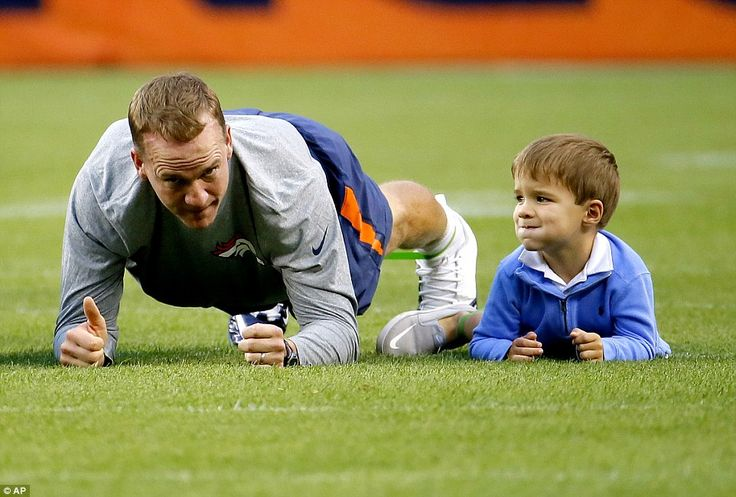 Plank: Denver Broncos quarterback Peyton Manning stretched with his four-year-old son Marshall on Thursday night before a home game