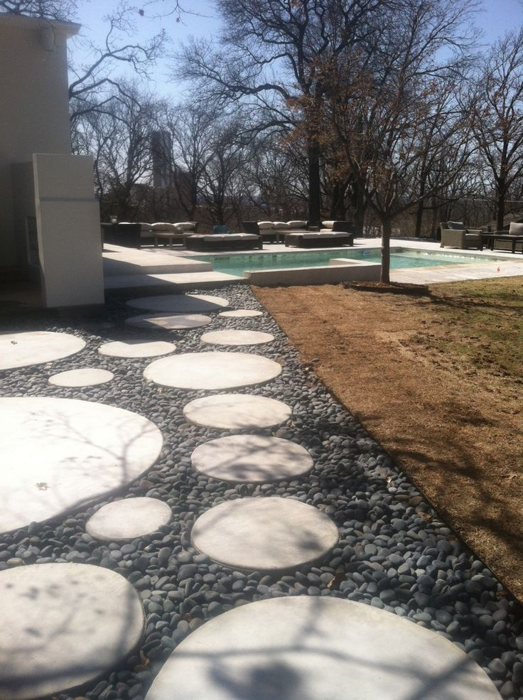 Round Pavers Installed To Compliment The Landscape