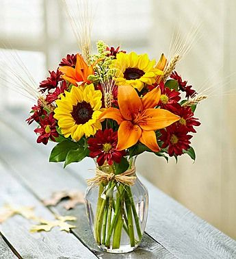 Orange tiger lillies and sunflowers <3 <3