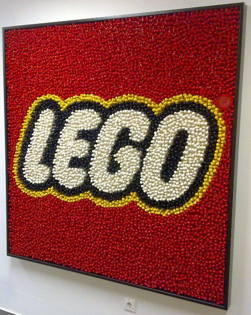 An enormous LEGO logo built from monocolour minifigures in the office of the LEGO Hungary.