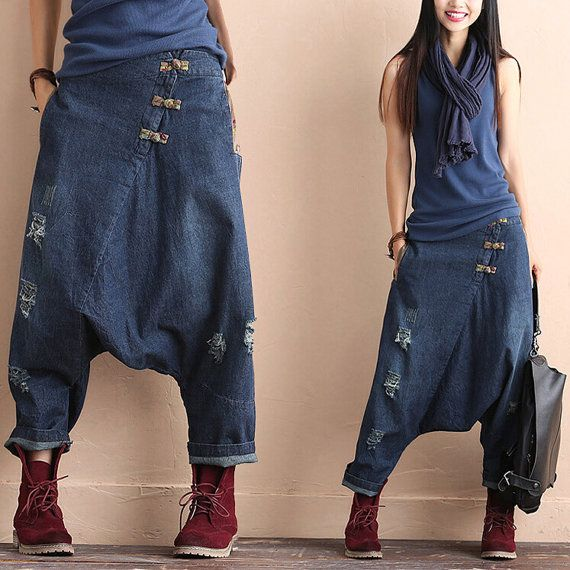 Fabric: 100% cotton Process: broken washing grinding white buttons more pockets Style: baggy pants Height: nine minutes of pants The waist type: tall waist Classification of fabric: cotton denim Color:blue    SIZE: A single size Height 85 cm/33.5in Waist 70-90 cm/27.6-35.4in hips 120 cm/47.2in openning 40cm/15.7in