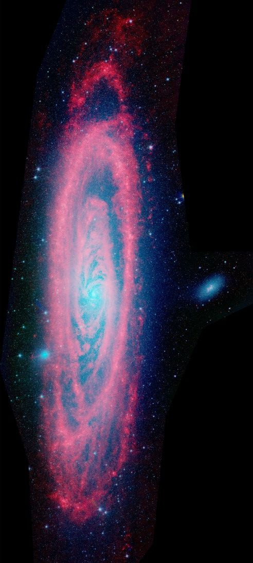 This wide, detailed Spitzer Space Telescope view features infrared light from dust (red) and old stars (blue) in Andromeda, a massive spiral galaxy a mere 2.5 million light-years away.