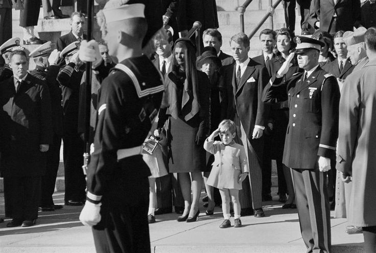 Junior salute John F. Kennedy Jr., 3, salutes as the casket of his father is carried out from St. Matthew's Cathedral.
