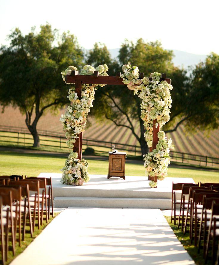 Wedding Ceremony Altar Alternatives: Voluptuous Cascade Of White And Cream Flowers Twining