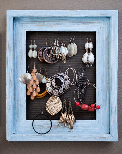Earring Display Frame. All you need is a wood frame, screen door fabric, and staple gun. And, of course, a super cute earring collection.
