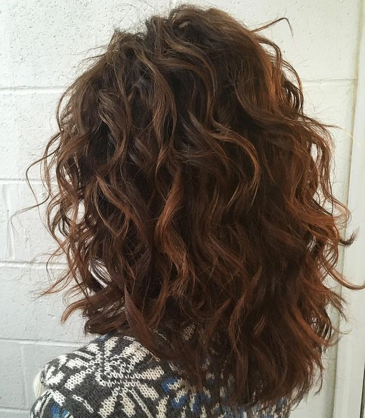 Shoulder-Length Layered Cut for Curly Hair