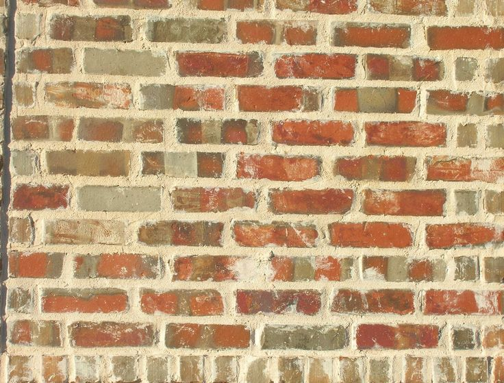 Mortar over edges of brick makes brick look old -called overgrout joint