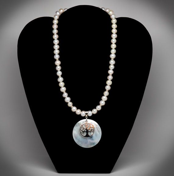Check out this item in my Etsy shop https://www.etsy.com/listing/270077681/pearl-necklace-with-tree-of-life-pendant
