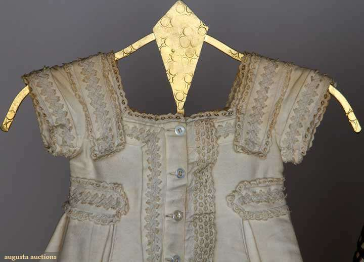 "Both 1-piece: 1 1869 toddler's white corded cotton, soutache bands & eyelet lace trims, high waist belt w/ back peplum, excellent; 1 little boy's taffeta in brown & white gingham, knife pleated skirt, brown & grey silk gros grain trim, matching cape & extra fabric, excellent; t/w 1 c. 1875 boy's white cotton cord jacket, eyelet & soutache trims, L 15.5"", (missing skirt, tears in underarm & lace) fair. Brooklyn Museum Augusta Auctions 2012"