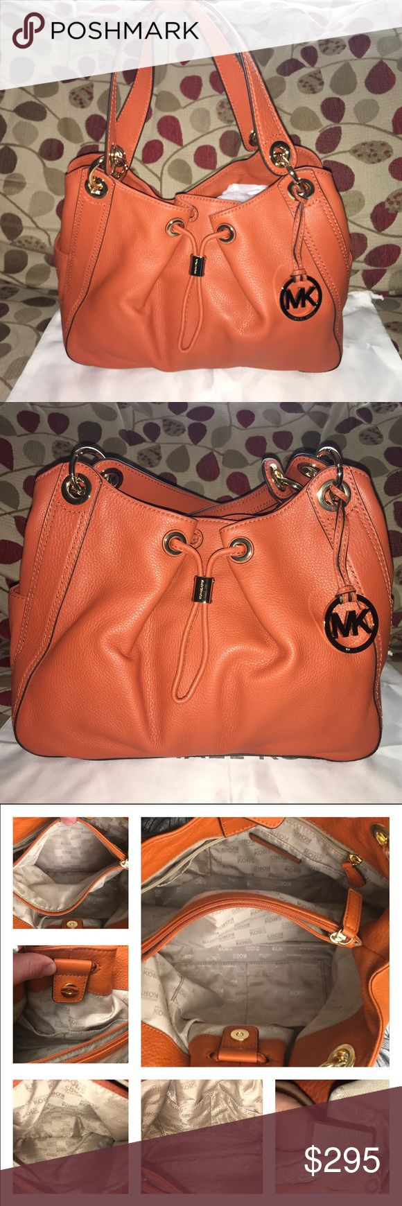 """NWOT Michael Kors Ludlow in Burnt Orange New Michael Kors Ludlow in Burnt Orange Pebbled Leather and Shiny Gold Hardware! Stunning bag for any occasion! Bag is logo lined, middle zip divider, 1 zip, multiple slip pockets, exterior has an open pocket at each end! The O rings and Drawstring accents are Gorgeous! Bag closes by magnetic snap, double handle drop is 9""""measures approx 13 x 10 x 5.5 includes dust bag! 🚫no trades price firm🚫 MICHAEL Michael Kors Bags Shoulder Bags"""