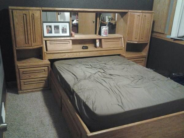 Oak queen bed for sale in Ruzi_garage Sale in Monticello , MN for . This is a beautiful oak queen bed. It has two standing towers and a head board with shelves. The headboard has three mirrors. there are also four large drawers underneath the bed. Each tower has two drawers and two shelves. The bed is in great shape no scratches on it. The mattress is six months old.