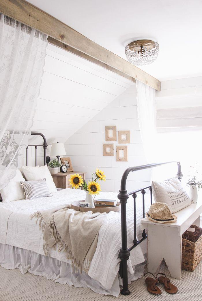 A feminine lace curtain hanging from a wooden beam creates the ideal hideaway…
