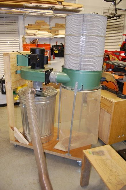 Dust Collector. Don't use a Trash Can Make a sealed box with a access and then the big stuff will fall but the larger stuff will not go through the prop.