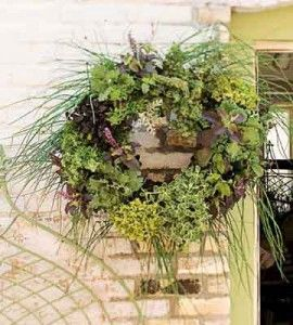 Hang your DIY wreath either where it can be seen, or where it's handy to cut fresh herbs for your meals. countrywomanmagazine.com