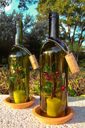 Wine Bottle Candle Shelter. I posted a similar one before but this one is really nice and I like the cork hanging from the chain and the artwork on the bottle.