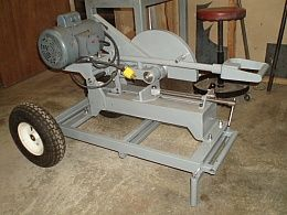 Chop Saw Homemade heavy-duty chop saw mounted on a wheeled frame and featuring a retractable handle