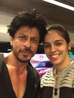 "Check out! Shah Rukh Khan meets Saina Nehwal on the sets of ""Dilwale."""