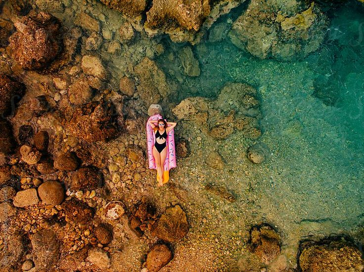 Aerial view with woman resting on the beach, Catalonia, Spain. by Javier Pardina for Stocksy United