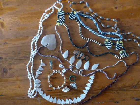 Description: Bulk lot of mixed jewellery pieces mostly beach themed or boho. Many of the pieces have shell beads or wooden beads. An eclectic mix with some interesting pieces which are ideal for re-purposing, assemblage, mosaics, craft, art or repairs. There are also a couple of Malibu pins which seemed to fit the beachy theme.  Some of the more interesting items are two standout MOP leaf shape pieces perfect for craft projects and they are vintage pieces. There is a fish resin brooch which…