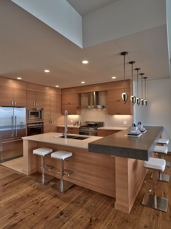 Contemporary Kitchen with Pendant light, Corian counters, Slate counters, European Cabinets, U-shaped, Limestone, Flush