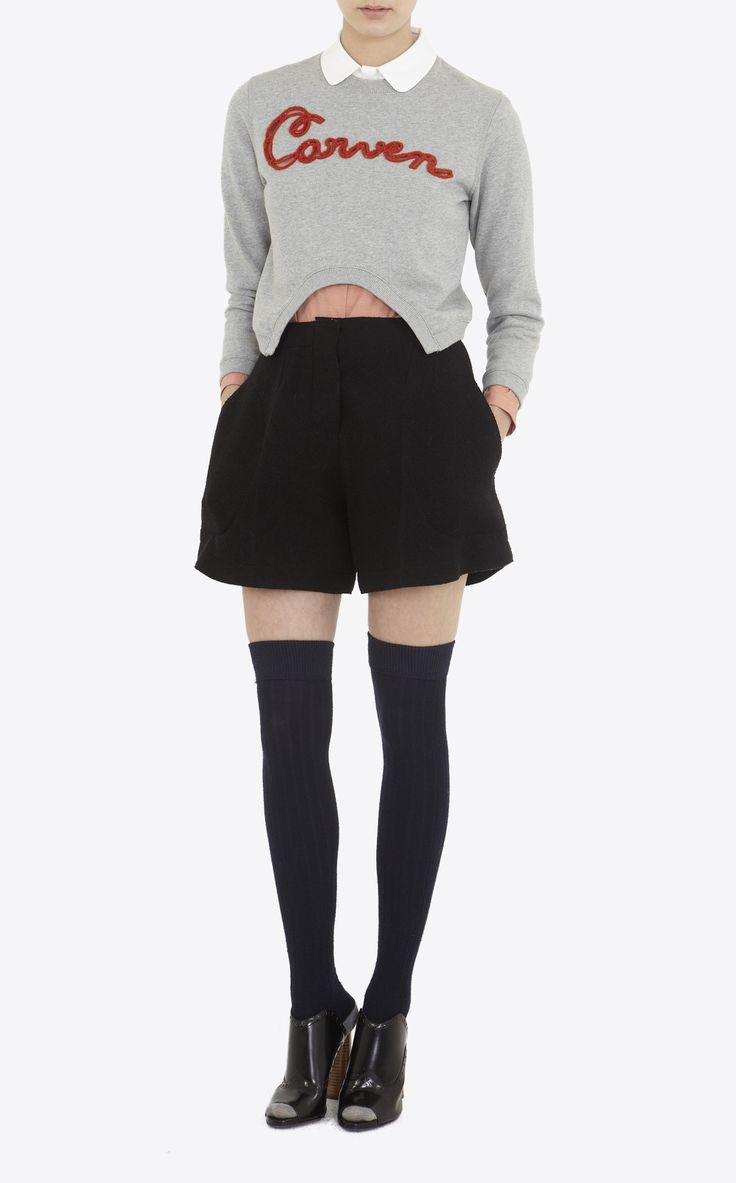 """Short fleece sweater with """"Carven"""" embroidery, round neck, rounded cut on the front bottom, ribbed cuffs and bottom."""
