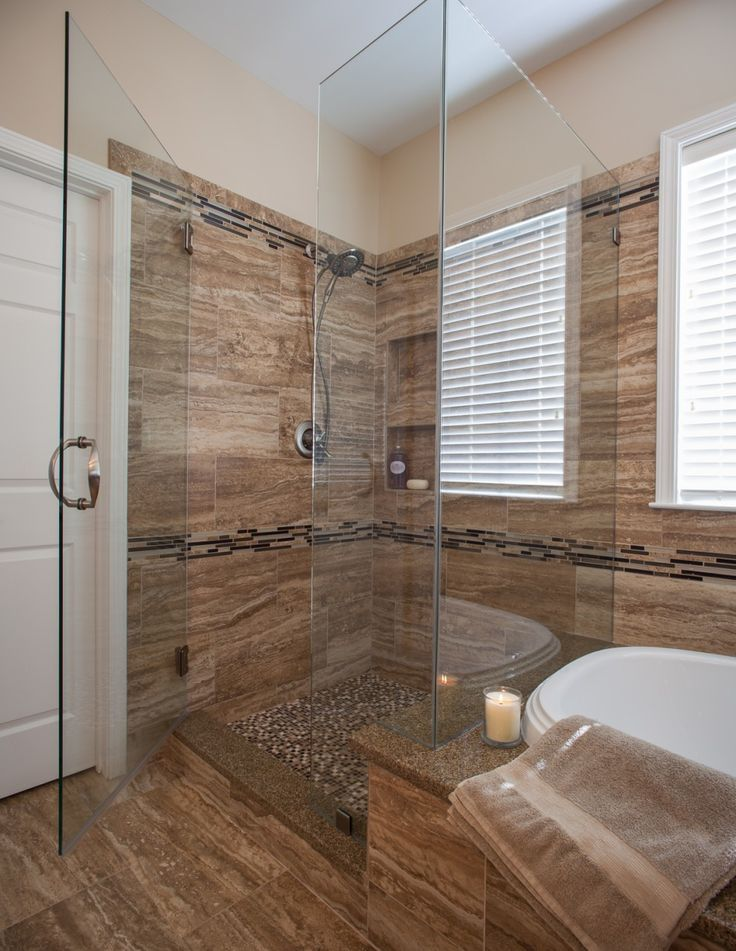 Bathroom. Small Master Bathroom Alongside Medium Shower Enclosure With Large Clear Glass And Tan Wood Vinyl Flooring In Addition White Under-mount Bathtub With Brown Flokati Base Towel.