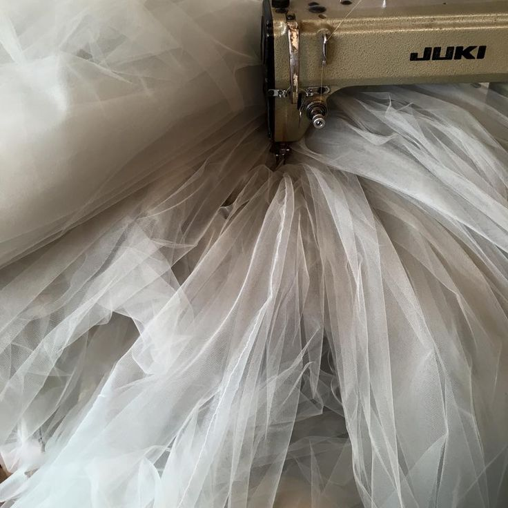 Meters and meters and meters of grey tulle being sewn in our atelier on our beloved sewing machine x