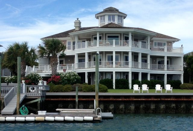 6 Sounds Point is a 5 bedroom 4.5 bath waterfront home that is over 4300 square feet. Located on the private island of Figure Eight Island located in Wilmington, NC.