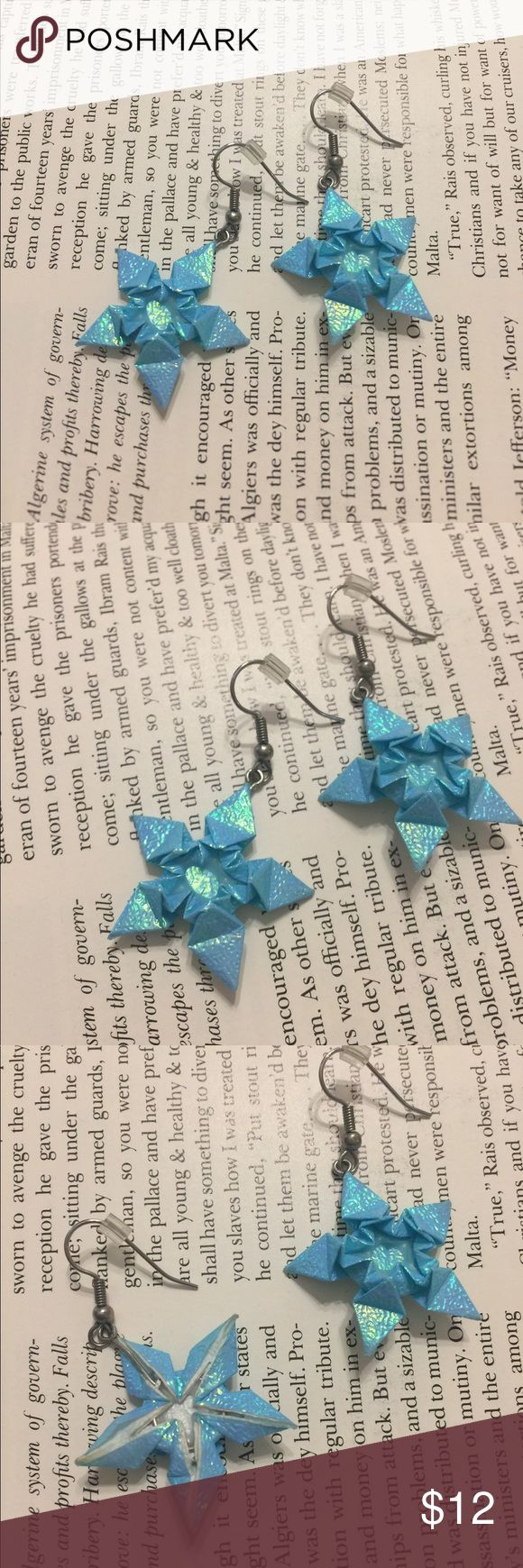 Origami snowflake earrings Looking for something special and one of a kind? These petite snowflakes are handmade origami earrings! Made of beautiful sky blue iridescent paper and hung from fishhook ear wires. Comes with rubber stoppers.   No swapping, but I do offer bundle discounts.    #snowflake #earrings #handmade #origami #winter #snow handmade Jewelry Earrings
