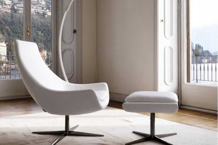 Chair of organic conception, seat cushion foam. Swivel base with four spokes in chrome.