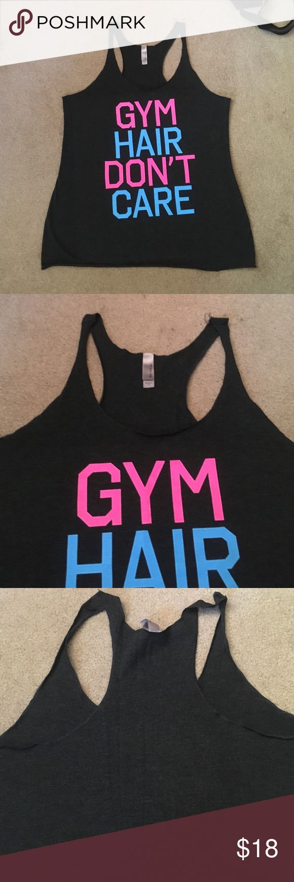 Grey gym hair don't care tank top Cute workout tank, only worn once. Has a couple loose threads at the top of one of the straps should be easy to sew down or trim. Lightweight and perfect for working out. 50% polyester, 25% cotton, 25% rayon. Tops Tank Tops