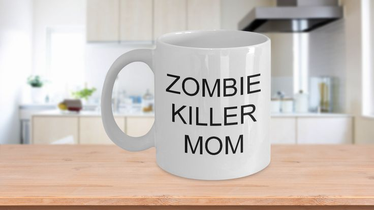 """* JUST RELEASED * Just for your zombie loving mom, this funny zombie coffee mug makes a great gift - for Mother's Day, birthday, Christmas or just to say I love you. She'll love drinking her morning coffee in this """"Zombie Killer Mom"""" funny coffee mug. Limited Time Only - This itemis NOT available in stores."""