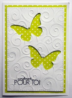 Butterflies punched from embossed white cover backed with scrapbook paper.