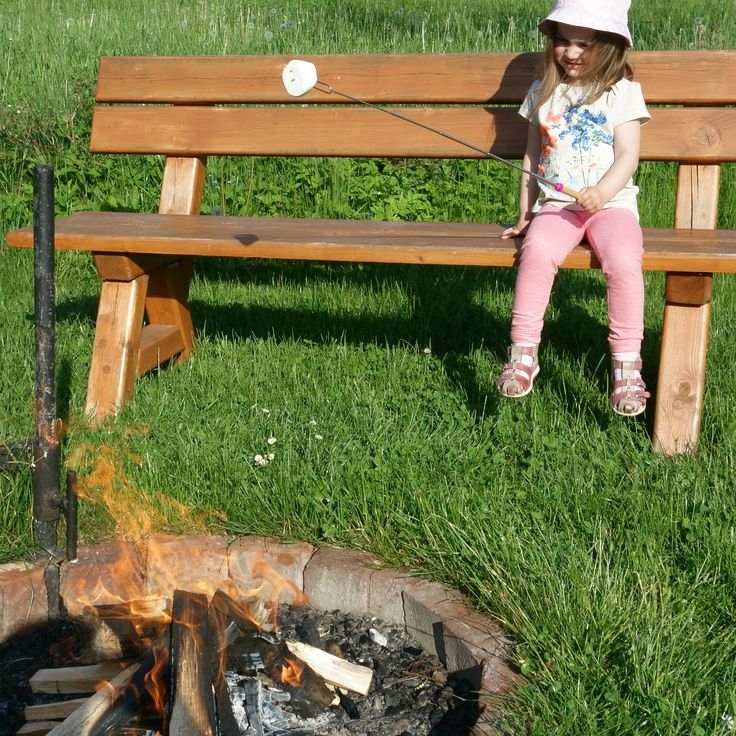 Backyard fire pit and golden marshmallow. Perfect time and funny moments. Keep your kids a safe distance away from the fireplace and enjoy your kids smile! Telescoping marshmallow roastign sticks.  www.marshmallow-roasting-sticks.com