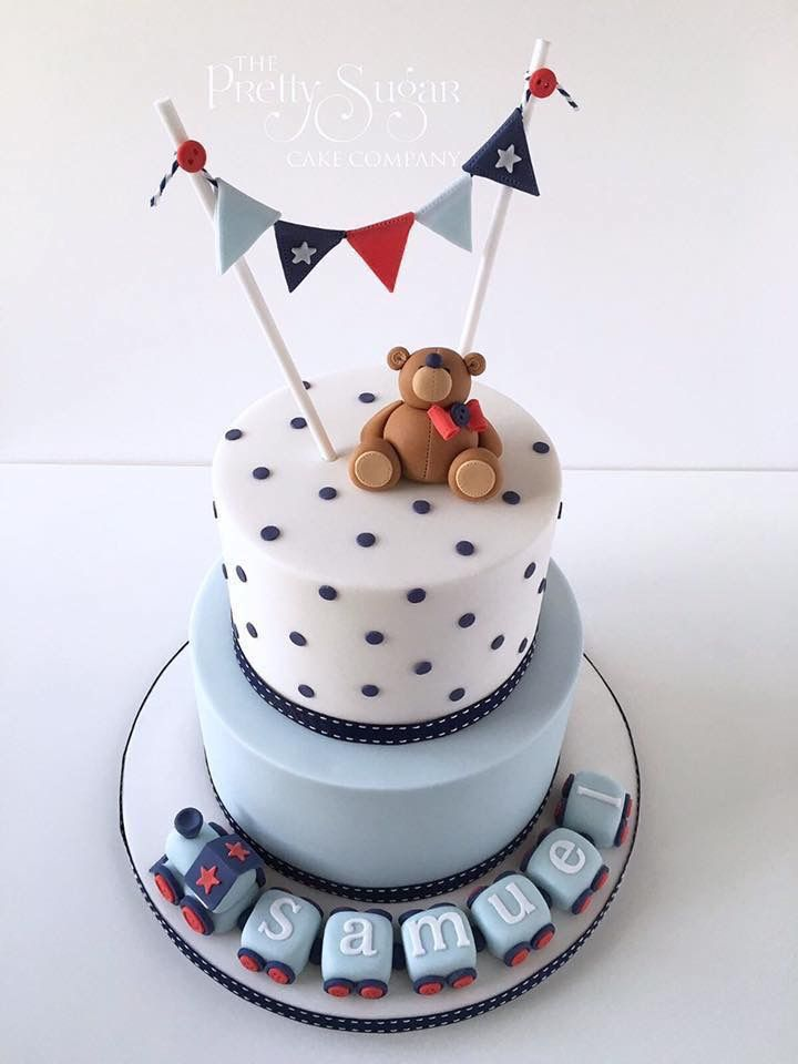 Navy blue, red and white polka dot christening cake with teddy, train and bunting detail