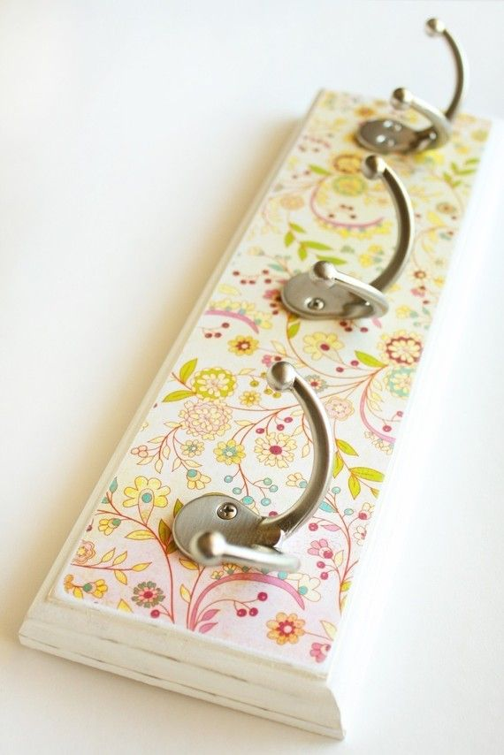 Wallflower Rack (any coordinating scrapbook paper--I think-mod podge on wood, add hooks!)