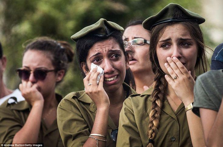 In Nahariya, Israeli soldiers weep at the grave of Israeli Sergeant Adar Barsano, who was ...