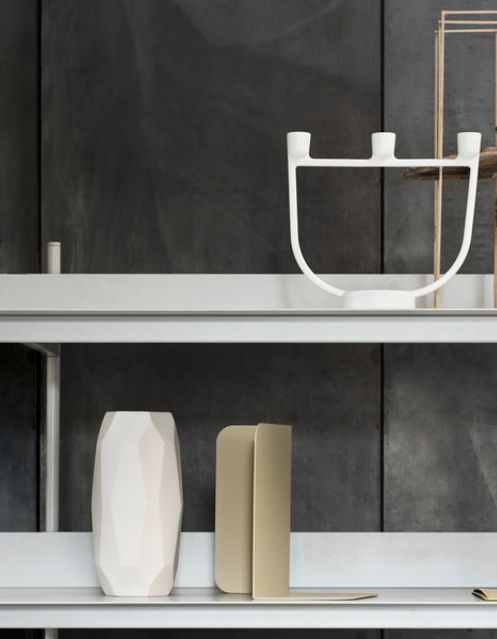 The Muuto Open Candelabra is a contemporary candle holder designed by Jens Fager and characterized by its open shape and graphic details.