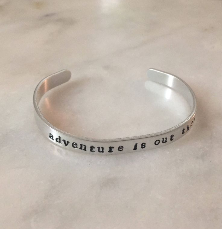 Adventure is Out There Metal Stamped Bracelet Cuff by BoomsCloset on Etsy https://www.etsy.com/listing/540261953/adventure-is-out-there-metal-stamped