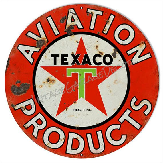 texaco gasoline advertising sign round
