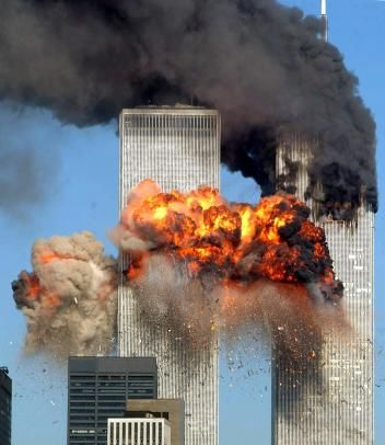 Smoke and flames billow as United Airlines Flight 175 crashes into the World Trade Center's south tower on 9/11, killing everyone aboard and hundreds more inside the building.